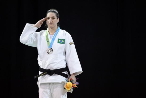 Saiba por que os brasileiros estão prestando continência quando ganham medalhas no Pan Harry How / AFP/