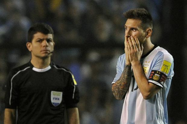 Luciano Périco: será a noite da calculadora na mão e de futebol brigado em campo Alejandro Pagni/AFP/