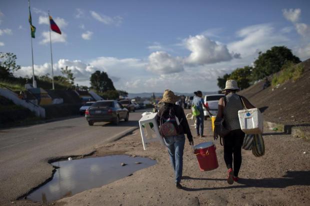 Diário Gaúcho te ajuda a entender a situação dos venezuelanos no Brasil Mauro PIMENTEL/AFP